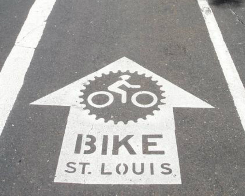 A bike path shows the Bike St. Louis logo